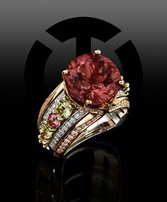 From the Flora collection, this 18K Green gold, 20K Rose gold and Platinum ring features a round cut Tourmaline accented by light pink and green Garnets and round brilliant cut Diamonds. #coffinandtrout #jewelry #tourmaline #garnet #diamonds