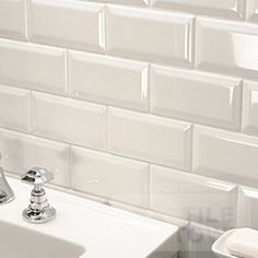 White Brick Bathroom Wall Tiles Staggered alms tiles actualize a brick-like pattern. Brick Effect Tiles, Brick Tile Floor, White Brick Tiles, White Brick Houses, Brick Tiles Bathroom, Bathroom Wall, Wall Tiles, Family Bathroom, Bathroom Faucets