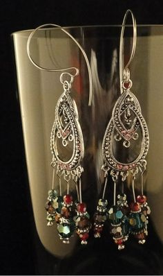 """Custom Sterling Silver Hand Crafted Ear Wires with Round Green and Purple crystal beads accented with pewter beads with crystal headpins.  4"""" in length."""