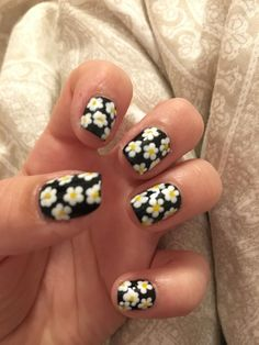 Get ready for spring with this super easy flower nail art design You can switch up the colors to make it suitable just for you. If you don't own a dotting tool, just use a toothpick and you're ready. Just start with the centre dots, stippling around five to seven dots all over the nail, then go back with another color and draw the flower pedals. Have fun