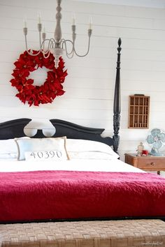 For the master bedroom, add a red poinsettia wreath above the bed and a red quilt.  Voila!  Those two simple touches make this space ready for the holidays.