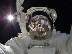 This picture is so bad ass! (Astronaut Aki Hoshide self portrait in space)