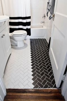 I would probably keep the floor one colour and make the theme white and grey instead of black but that's what I want my bathroom to look like.
