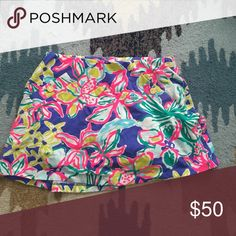 Lilly Pulitzer Skort This bright and fun floral skort by Lilly Pulitzer is perfect for running errands or catching up with friends over lunch! new without tags! Lilly Pulitzer Shorts Skorts