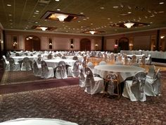 White poly banquet with light silver satin sash