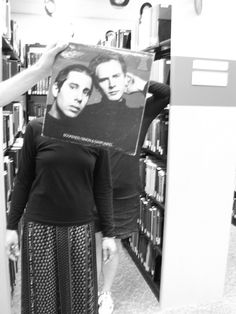 """Old friends… stood in the shelving like bookends. (BGSU Music Library utilizing """"sleevefacing"""" to promote their collection in a whimsical, attention-gaining fashion. Perfect for music nerds like me. Music Library, Library Books, Rock Puns, Call Me Al, Bowling Green State University, Andrew Smith, Simon Garfunkel, Dry Humor, Face The Music"""