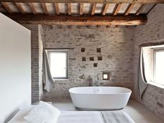 tub in bedroom, love the wall behind it