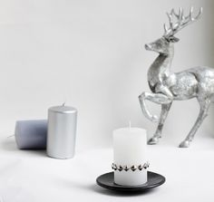DIY candle decoration idea: Use rivets to give candles some edgy style for Christmas.