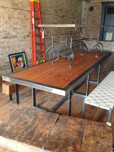 now that's a dining table! Old bowling alley lanes wood