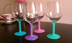 I WOULD LOVE TO MAKE THESE WITH CHAMPAGNE FLUTES & TURQUOISE GLITTER FOR THE HEAD TABLE! Cover base with Modge Podge, sprinkle with glitter, then spray lightly with krylon clear paint. Hand wash only!