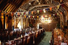I love the beams in this room. A small great hall. Just needs benches instead of chairs and banners of great medieval houses in place of the little pennants.