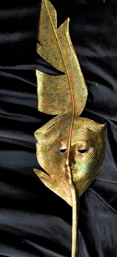 Gold Feather Handheld Mask - Handmade Venetian Mask.  via Etsy.