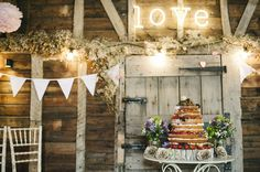 Naked cake, rustic wood barn & pretty fairy lights & bunting