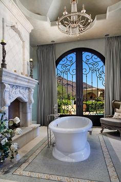 Luxury Master Bathroom. this is so cool with the fireplace.