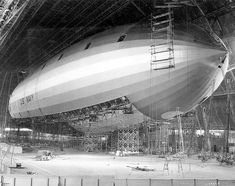 """Construction of the U.S.S. Macon Airship  """"USS Macon (ZRS-5) was an airship built and operated by the United States Navy for scouting. She served as a """"flying aircraft carrier"""", launching Curtiss F9C Sparrowhawk biplane fighters. In service for less than two years, in 1935 Macon was damaged in a storm and lost off California's Big Sur coast."""""""