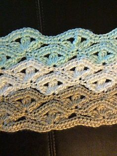 irish wave ripple blanket in crochet. 4 row repeat. ravelry pdf download after free signup.