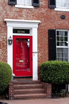 red storm door and red front door House Front Door, House, Front Door Colors, Painted Doors, Interior Shutters, House Front, House Exterior, Exterior Doors, Red Brick House