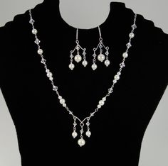 Pearl and crystal links on sterling silver wire make this unique necklace and earring set.