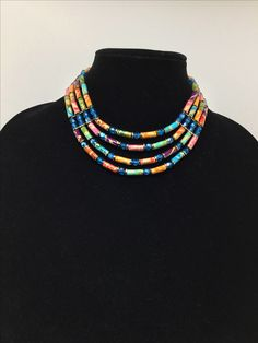 Handmade four-strand fabric bead necklace accented with metal and Czech glass beads.