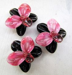 Lampwork garden: Black with pink lampwork orchids