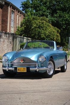 Now this is a real automobile. I could cruise in this car all day...Please somebody let me! 1958 Aston-Martin DB Mark III DHC