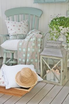 Beach Cottage Porch  Like it all - like the colors and design of the throw & candles in the lantern~