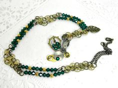 OOAK Steampunk Necklace With Emerald Swarovski by BeadsGalore2,