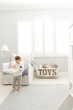 """Designed for adventure. Amanda S. Gluck, lifestyle blogger of fashionablehostess.com, reveals the """"big boy room"""" she designed for her son with RH Baby & Child. Featuring our Classic Shelter Slipcovered Swivel Glider and Industrial Toy Basket."""