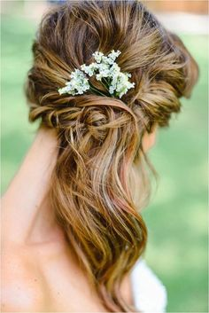 boho woven side swept wavy hair with baby's breath