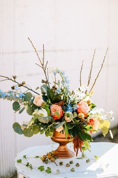 wedding centerpieces - photo by Sarah Libby Photography http://ruffledblog.com/bold-copper-bridal-inspiration-with-a-dripping-cake