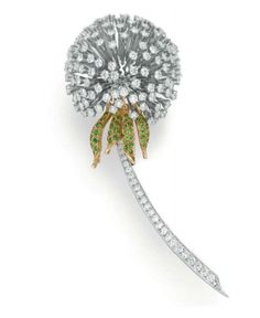 Diamond and Tsavorite Garnet dandelion brooch by Tiffany & Co. - designed as a dandelion flower, with articulated circular-cut diamond seeds, to the circular-cut tsavorite garnet leaves and graduated circular-cut diamond stem, mounted in platinum and gold High Jewelry, Modern Jewelry, Jewelry Art, Antique Jewelry, Gold Jewelry, Vintage Jewelry, Jewelry Design, Jewellery, Bijoux Art Nouveau