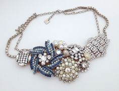 Love this idea to make a necklace out of a bunch of antique brooches.