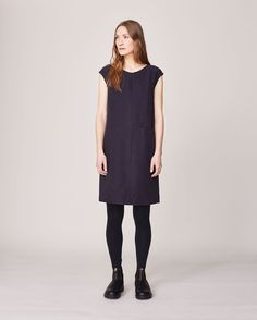 Simple tunic dress in a soft, peachy sand-washed silk/linen. Soft V-neck and back. Grown-on cap sleeves. Centre seam detail at front with single slip-in pocket in waist seam.
