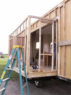 This is FANTASTIC!  Check out how to build a slide out for your tiny house…
