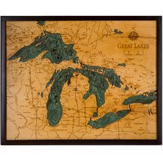 The Great Lakes Wood Chart by Below the Boat. Starting with a bathymetric chart (the underwater equivalent of a topographic map), the contours are laser-cut into sheets of Baltic birch and glued together to create a powerful visual depth.
