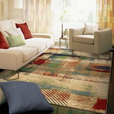 Abstract design combined with bright color palette  makes our Restless Abstract Area Rug a beautiful addition to your home. This motif is enhanced with shades of green, orange, red, ivory, tan, blue,and purple. This rug is sure to compliment any space.