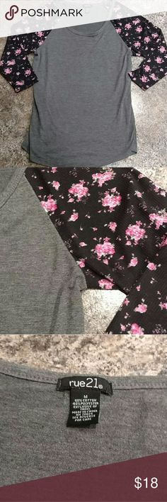 Shirt 👚 NOT LuLaRoe. Please refer to 3rd pic with real brand. (Just as cute, but looking for exposure). Buy this flattering shirt with floral print sleeves. Half the price of LLR blouses! Re-posh. Never wore. Appears to be in great condition (no stains and rips). Please ask any questions. LuLaRoe Tops