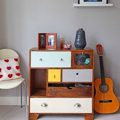 A vintage-style chest of drawers from Oliver Bonas provides colourful storage and adds a retro look to this otherwise modern hallway. The guitar and accessories add a personal touch. Grey Hallway, Modern Hallway, Hallway Pictures, Hallway Ideas, Small Chest Of Drawers, Chair Pillow, Small Hallways, Storage Design, Storage Ideas
