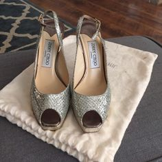 """Jimmy Choo 'Clue' Glitter Slingback Pump 35.5 No trades. Use the offer button.                          Gently used (worn for wedding). Please see pictures. Retailed for nearly $700 at Nordstrom.                                                   Smooth leather outlines a gorgeously glittering fabric pump styled with a flirty peep toe and narrow slingback strap.  4 1/4"""" heel; 3/4"""" platform; 115mm pitch. Adjustable strap with buckle closure. Fabric upper/leather lining and sole. Made in Italy…"""