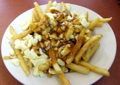 Poutine  Throw in a side of Poutine, a Canadian staple consisting of French fries topped with cheese curd and slathered with brown gravy. Or you can try a side of ...