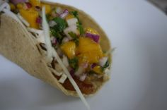 Fish tacos baja style with mango serrano sauce