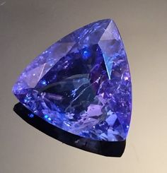 Outstanding Trillion Tanzanite Gemstone (4.35) 12x12 mm Tri-Cut Rated: 5 / 5 based on 5 customer reviews $760 In stock Product description: The deep blue of the tanzanite is fantastic, and runs from u