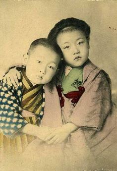 Very young Japanese brother and sister in kimono. Hand-colored photograph.Late…