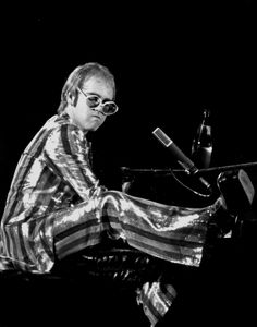 Elton John - I had a huge poster of him on my wall when I was around fourteen...somewhere around there.