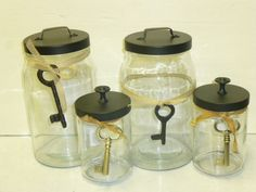 Use any old glass jar with a lid (like mayo jars, pickle jars, you name it), glue on a knob or handle and spray paint!!