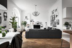 Black and white living room filled with art Follow Gravity Home: Blog - Instagram - Pinterest - Bloglovin - Facebook
