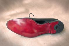Hand coloured leather soles - oxblood.   Dominique Saint Paul luxury shoes and leather goods, made to order and hand coloured in Saigon, Vietnam.