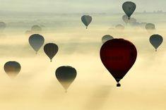 Hot air-balloons take off at a hot air balloon festival in France.