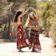 Dancing hippies in boho chic maxi skirts. For the BEST Bohemian fashion inspo FOLLOW https://www.pinterest.com/happygolicky/the-best-boho-chic-fashion-bohemian-jewelry-gypsy-/ now