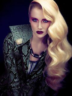 Amazing wavy blonde hair and croco coat.
